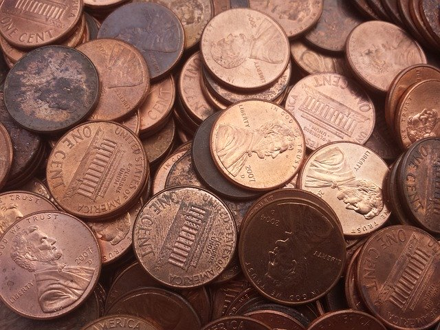 big stash of pennies waiting to be counted, sorted and rolled