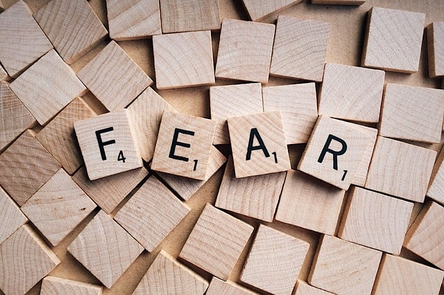 picture of scrabble letters that spell fear. overcoming financial fears.