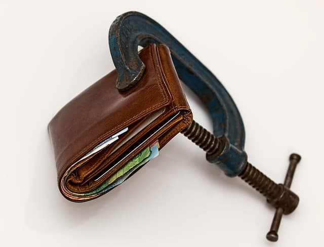 Living stingy. Locking away your money so you won't spend it.