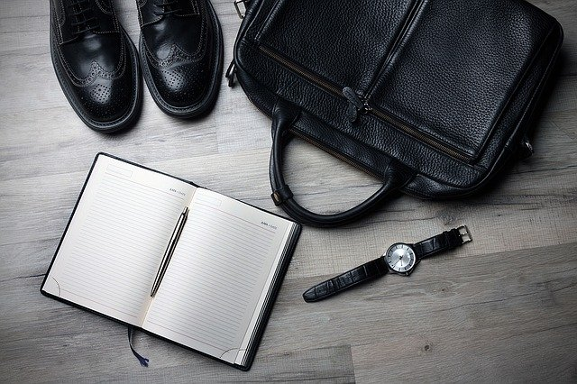 should i quit my job if it makes me unhappy - shoes, briefcase, watch of a former employee