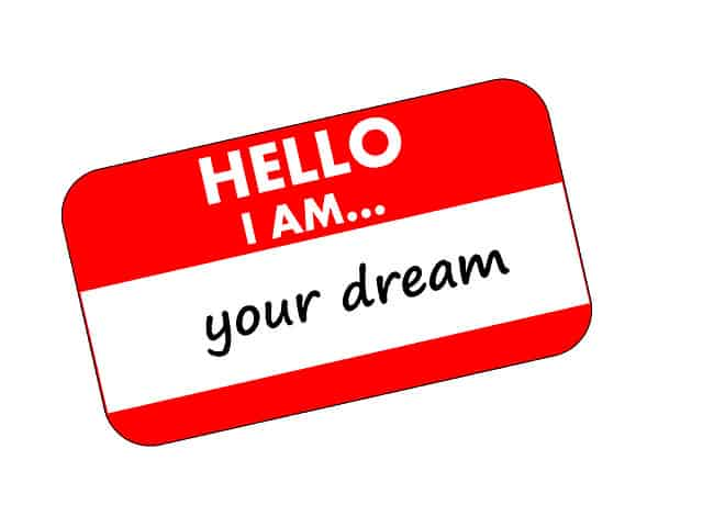 quit your job to live the life of your dreams. name tag reading hello i am your dream