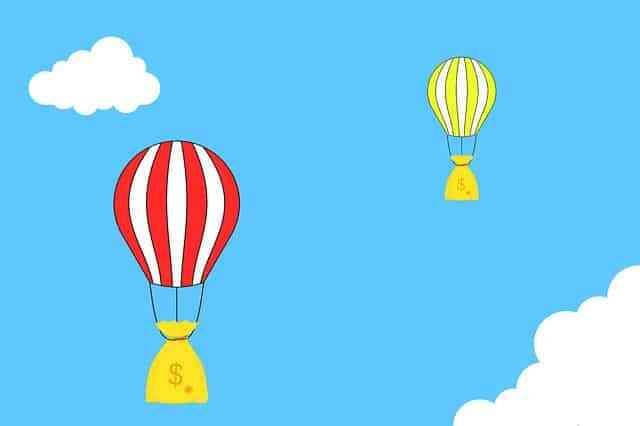 dream about money. coin bags full of money floating off into the sky on hot air balloons